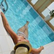 Happy woman in swimming pool — Stock Photo #29816113