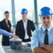 Stock Photo: Businessmin helmet