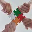 Group of business people assembling jigsaw puzzle — Stock Photo #31136499