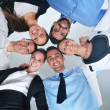 Business people with their heads together — Stock Photo