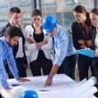 Stock Photo: Business people and engineers on meeting