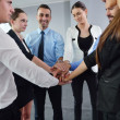 Stock Photo: Business people group joining hands