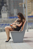 Happy young woman with puppy have fun — Stock Photo