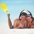 Happy young couple have fun at beach — Stock Photo #32723775