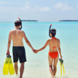 Happy young couple have fun at beach — Stock Photo #32724923