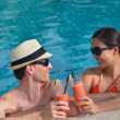 Young couple relax and toasting with  fresh drinks at poolside — Foto Stock
