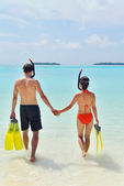 Happy young couple have fun at beach — Stock Photo