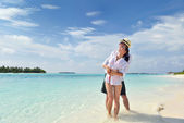 Happy young couple have fun on beach — Stock Photo