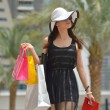 Beautiful woman goes for shopping — Lizenzfreies Foto