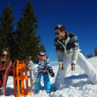 Family playing on fresh snow — Stock Photo #32933121
