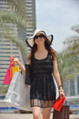 Beautiful woman goes for shopping — Stock Photo