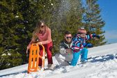 Family playing on fresh snow — Stock Photo