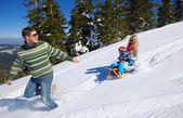 Family having fun on fresh snow at winter — Stock Photo