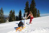 Family ridding sledge — Stock Photo