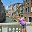 Tourist woman have beautiful vacation time in venice italy — Stock Photo #33734807
