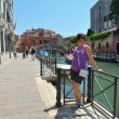 Tourist woman have beautiful vacation time in venice italy — Stock Photo #33734883