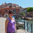 Stock Photo: Tourist woman have beautiful vacation time in venice italy
