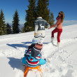 Family having fun on fresh snow — Stock Photo #33932645