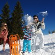 Family playing on fresh snow — Stock Photo #33932793