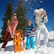 Family playing on fresh snow — Stock Photo #33932805