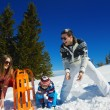 Family playing on fresh snow — Stock Photo #33932883