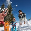 Family playing on fresh snow — Stock Photo #33932887