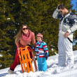 Family playing on fresh snow — Stock Photo #33935419