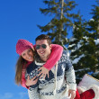 Couple in winter snow scene — Stock Photo
