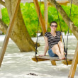 Beautiful girl on beach swing have fun — Stock Photo