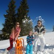 Family playing in snow — Stock Photo #34844917