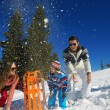 Family having fun on fresh snow at winter — Stock Photo