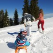 Family having fun on fresh snow — Stock Photo #34846629