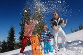 Family playing in snow — Stock Photo