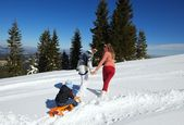 Family riding on sledge — Stock Photo