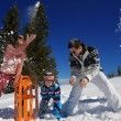 Family playing in snow — Stock Photo #34858965
