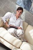 Woman reading magazine at home — Stock Photo