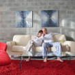 Relaxed young  couple watching tv at home — Foto Stock