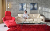 Happy young woman relax at home on sofa — Stock Photo
