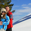 Young couple on winter vacation — Stok Fotoğraf #36053769