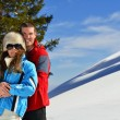 Young couple on winter vacation — Stock fotografie #36053769