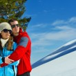 Young couple on winter vacation — Stok Fotoğraf #36054193