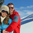 Young couple on winter vacation — Stok Fotoğraf #36054383