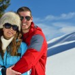 Young couple on winter vacation — Stock fotografie #36054383