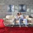 Relaxed young  couple watching tv at home — Stok fotoğraf