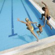 Happy young family have fun on swimming pool — Stock Photo #3670021