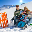 Family having fun on fresh snow at winter vacation — Stok Fotoğraf #36904527