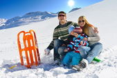 Family having fun on fresh snow at winter vacation — Stok fotoğraf
