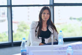 Business woman in a meeting at office — Stock Photo
