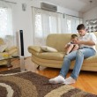 Father and son playing with tablet — Stock Photo
