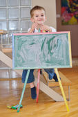 Boy drawing on school board at home — Foto de Stock